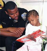 Policeman Reading with Child