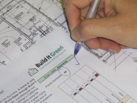 Photo of a project applicant completing a green building checklist