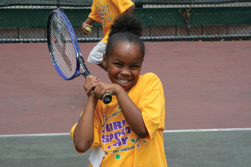 Photo of a girl playing tennis