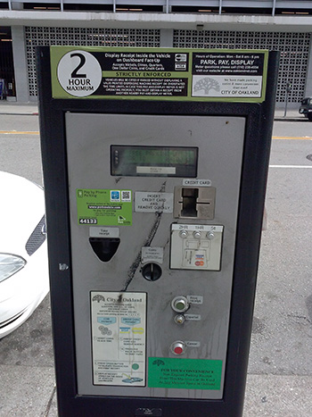 photo of multi-space parking kiosk used by the City of Oakland in many commercial areas