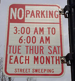 photo of no parking sign for street sweeping from 3 to 6 am on Tuesdays, Thursdays and Saturdays