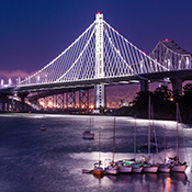 photo of the new Oakland span of the Bay Bridge illuminated at night