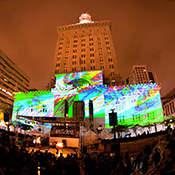 photo of art projections on the facade of the historic Oakland City Hall during Art & Soul