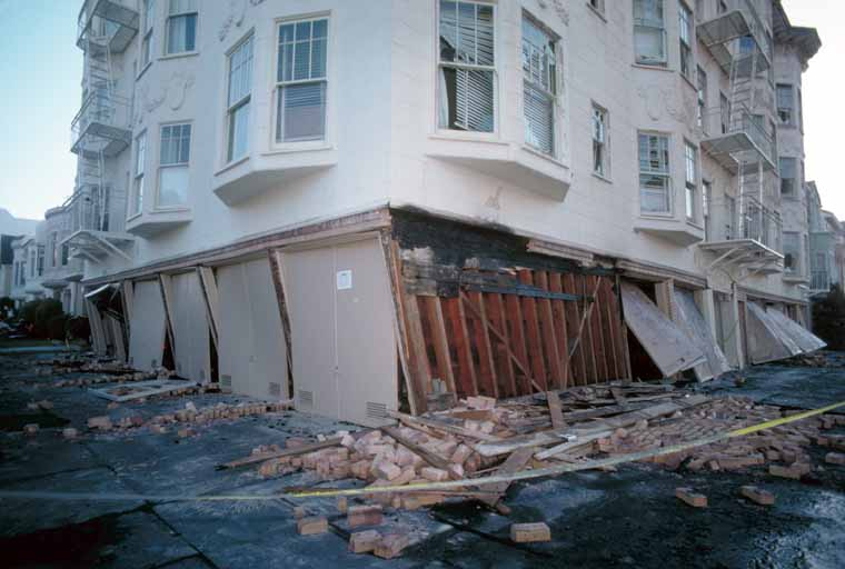 photo showing soft story apartment building damaged during earthquake