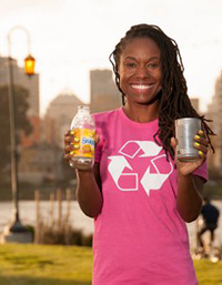 photo of young Oakland resident promoting recycling with Lake Merritt in the background