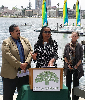 Photo of Councilmember Abel Guillen, Council President Lynette Gibson McElhaney and Lesley Estes at Measure DD media event on July 22, 2015