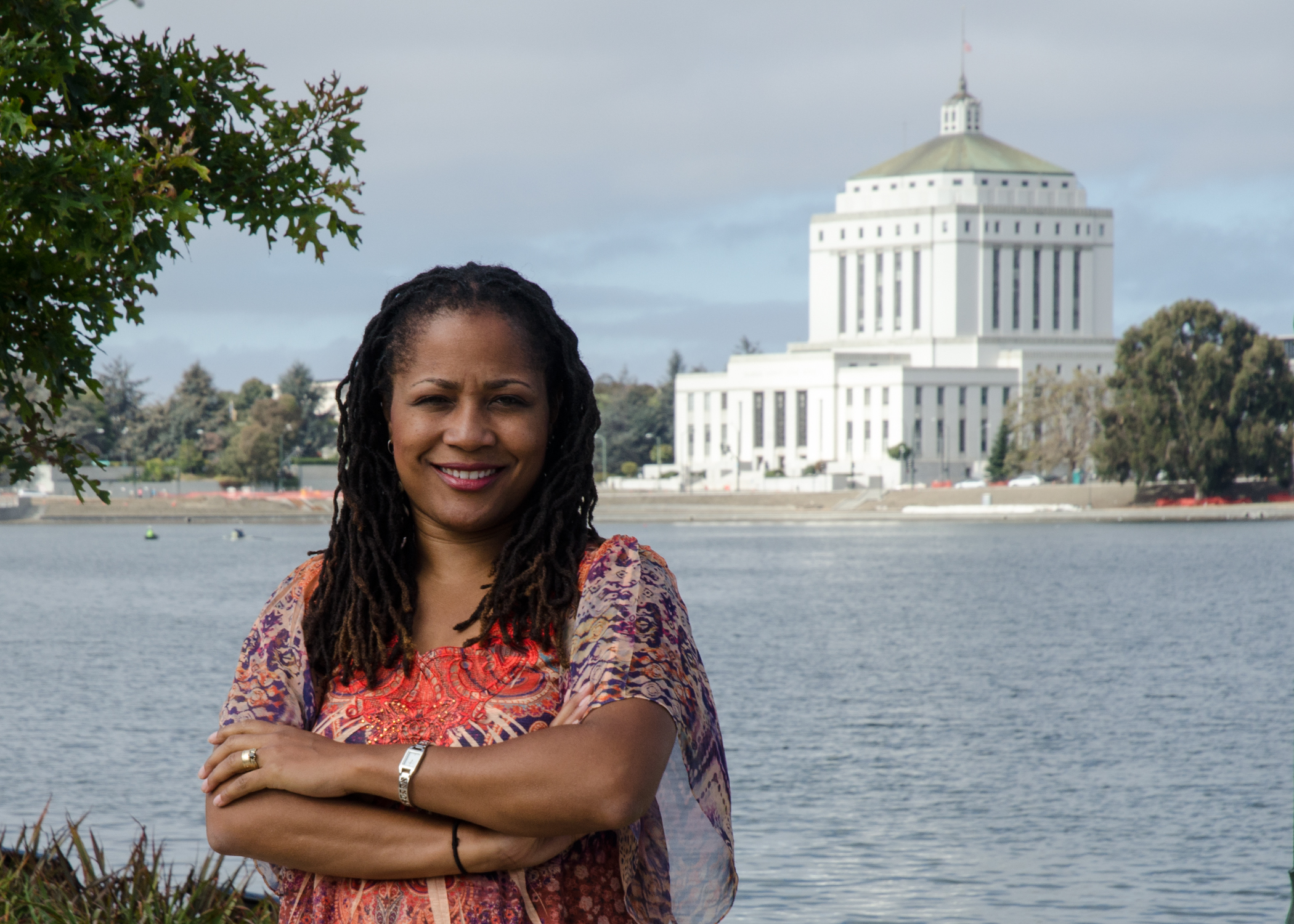 Photo of Councilmember McElhaney at Lake Merritt with Courthouse in the background