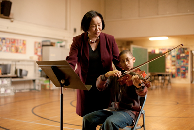 Photo of Jean Quan with a Violin Student