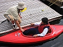 Photo of student getting into a kayak