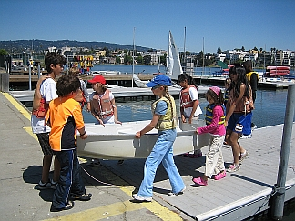 Photo of Students Carrying a Boat