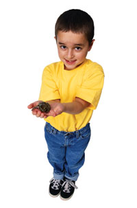Photo of a kid showing off a frog