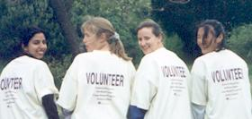 Photo of four teenage girls in Volunteer t-shirts