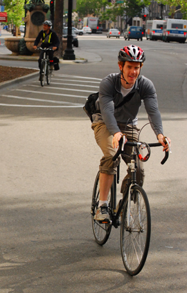 photo of bicycle rider in downtown Oakland