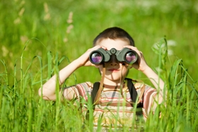 photo of boy with binoculars