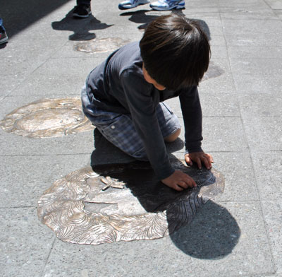 Photo of Child with Watershed Markers