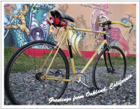 thumbnail photo of a yellow bicycle and mural