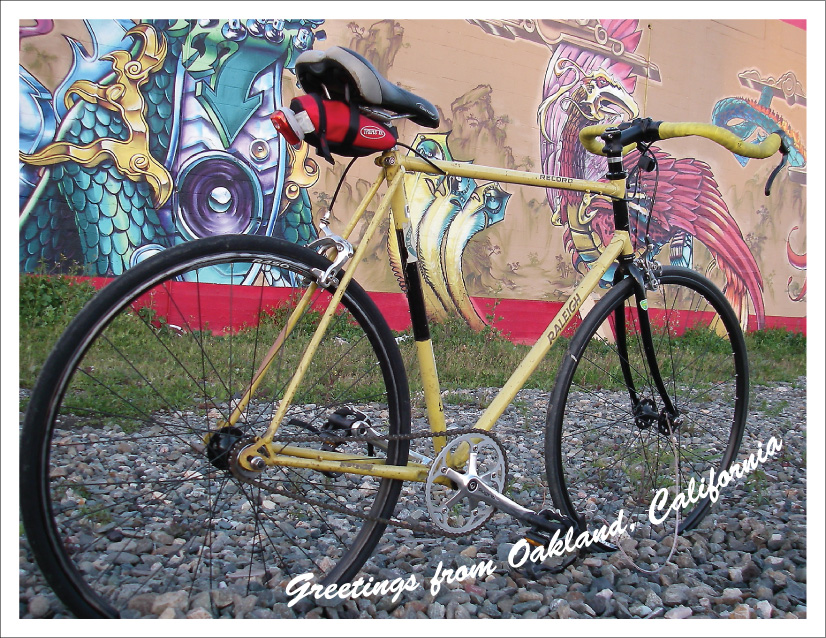 photo of yellow bicycle and mural
