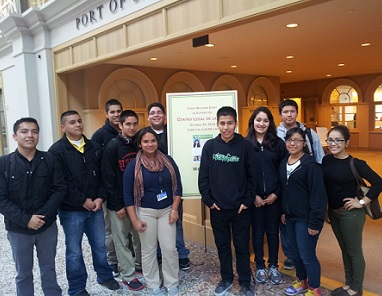 Photo of students at the Youth Law Academy Mixer posing in front of the event at Centro Legal de la Raza